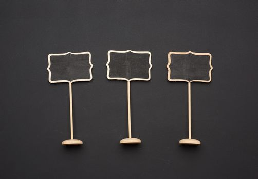 wooden pointer on a stick for writing text, black background, close up