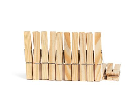 new wooden clothespins isolated on white background, close up