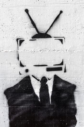 A representation of the mind control of the media on people.