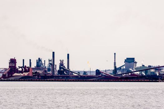 HAMILTON, ONTARIO, CANADA - APRIL 21, 2018: Large steel-making facilities occupy the shores of Hamilton Harbour.
