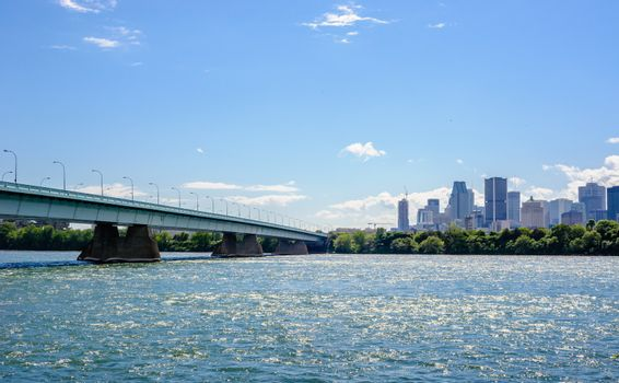 MONTREAL, CANADA - JUNE 15, 2018: The Concordia Bridge links the southern point of St. Helen's Island and Notre Dame Island to downtown Montreal across the St. Lawrence River.
