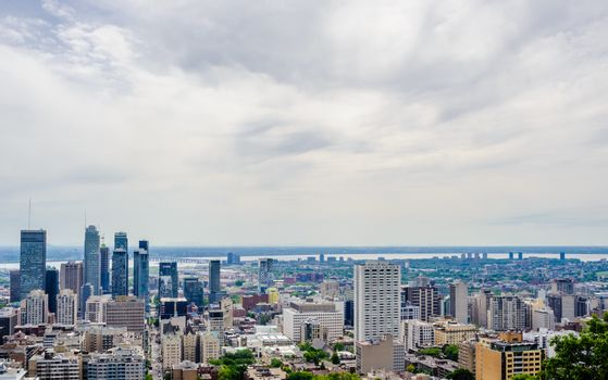 MONTREAL, CANADA - JUNE 16, 2018: Part of the dense downtown and surrounding areas can be seen looking south-east from Mount Royal.