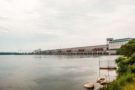 CORNWALL, ONTARIO, CANADA - JUNE 18, 2018: The Moses-Saunders Power Dam straddles the border between Canada and the United States, generating significant amounts of electricity and regulating the St. Lawrence River.