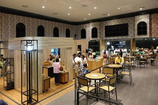 KAOHSIUNG, TAIWAN -- APRIL 14, 2019: A coffee shop inside the recently completed National Center for the Performing Arts located in the Weiwuying Metropolitan Park