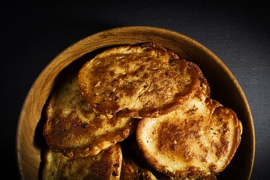 Sweet corn pancakes in a wooden plate