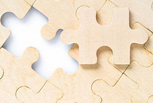 Close up shot of Missing jigsaw puzzle pieces on white background,business concept