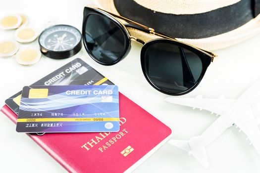 Passports and credit cards,sunglases,airplane on white background, Business travel and tourism concept