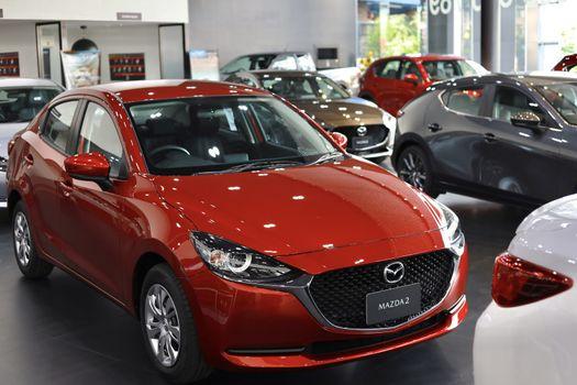 BANGSAEN,THAILAND 2020, car all new MAZDA3 MAZDA2 2020 brand japan red  color on room customer dealership in garage parked in showroom of thailand for transport Illustrative editorial image.