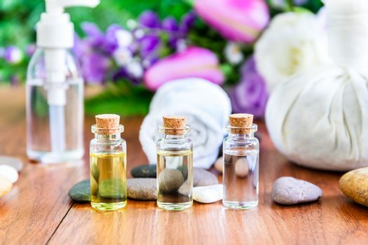 Spa concept, Essential oil in bottle, Thai Spa massage setting with bottle with essential oil and thai herbal compress balls