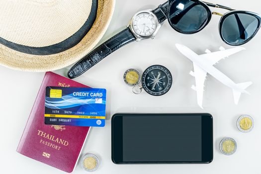 Traveling concept,smart phone, passport, credit card,sun glasses on white background