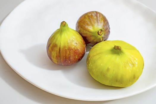 ready to eat fig fruits on white plate