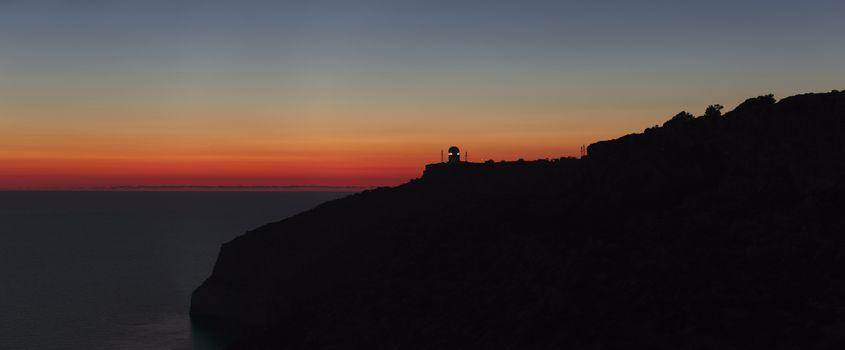 A beautiful sunset over calm Mediterranean waters at Dingli Cliffs in Malta