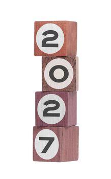 Four isolated hardwood toy blocks, saying 2027