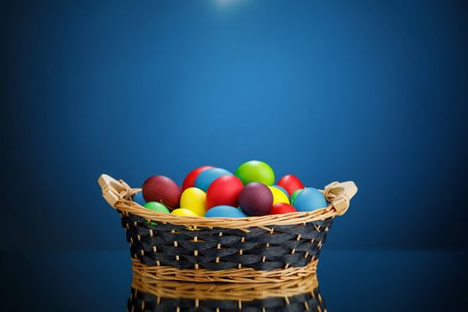 Easter color eggs in festive gift basket, blue background with copy-space