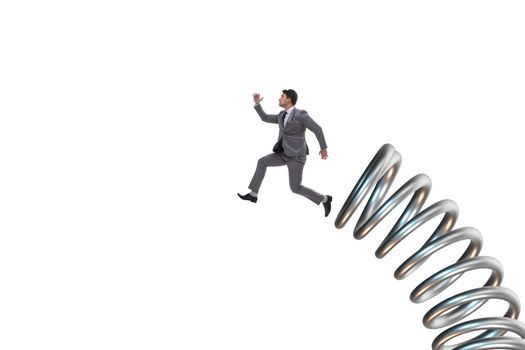 Businessman jumping from spring in promotion concept