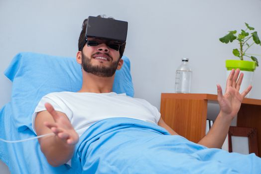 Patient in the hospital with VR glasses headset