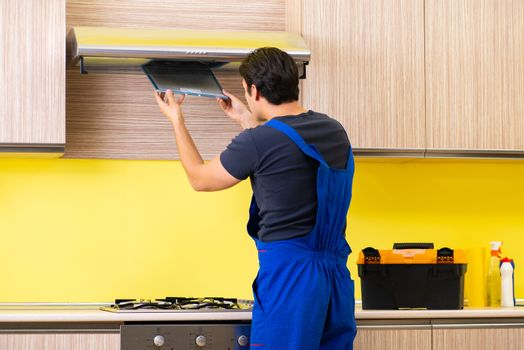 Young service contractor assembling kitchen furniture