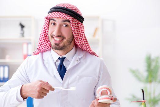 Arab dentist working on new teeth implant