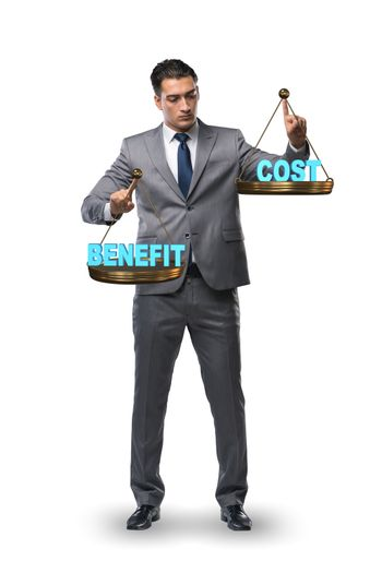 Businessman in cost benefit balance concept