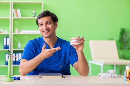 Man dentist working on new teeth implant