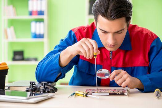 Computer engineer repairing broken desktop