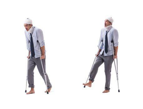 Injured businessman isolated on white