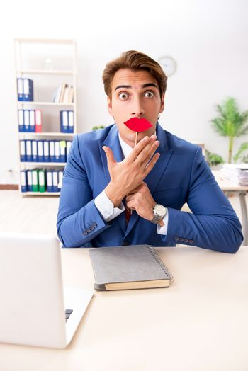 Funny bisinessman with fake lips in the office