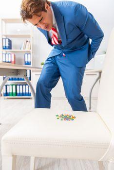 Office prank with sharp thumbtacks on chair
