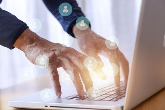 Business and social network concept. Businessman hands with laptop and social network map tree graph background. Businessman hands use computer network contact with customer and partners all the word.