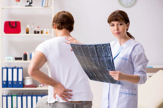 Female radiologist detecting cause of the illness