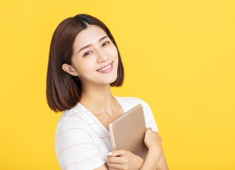 Smiling pretty girl holding  digital tablet computer
