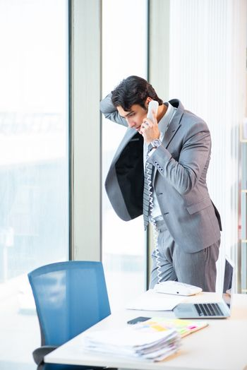 Young successful businessman working at the office
