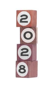 Four isolated hardwood toy blocks, saying 2028