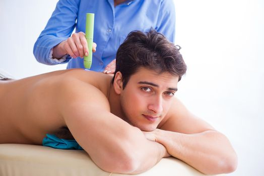 Patient in clinic undergoing laser scar removal