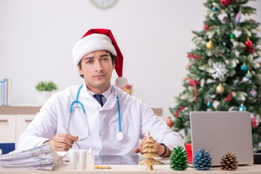 Doctor on the shift on christmas eve