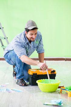 Young man doing home renovation