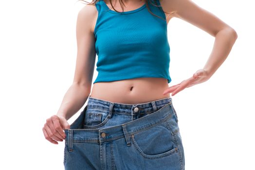 Concept of dieting with oversized jeans