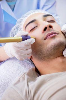Man visiting dermatologyst for laser scar removal