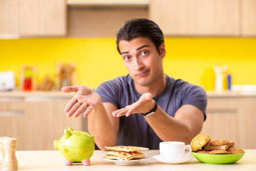Young man in unhealthy food concept