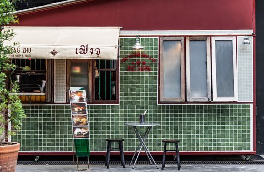 """Bangkok, Thailand - Aug 01, 2020 : Exterior design and frontstore decoration of """"FENG ZHU PORK SHOP & CO."""" Chinese retro style. Selective focus."""