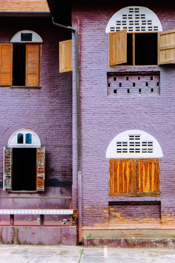 side view of classical brick British style building architecture in Nan province, Thailand