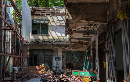 Bangkok, Thailand - 26 Jan 2020 : External of old house was left to deteriorate over time, Chinese Architecture style, Abandoned house, Destroyed house, Ruined house, Selective focus.