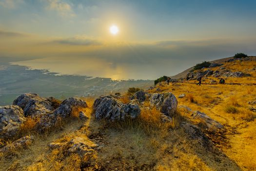 Arbel, Israel - August 14, 2020: Morning view of the Sea of Galilee, from mount Arbel, with visitors. Northern Israel