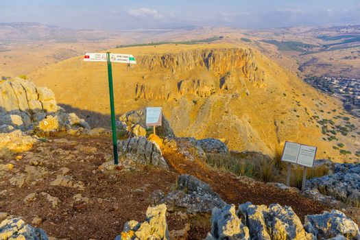 Arbel, Israel - August 14, 2020: View landscape and Mount Nitay from Mount Arbel National Park, with explanation signs. Northern Israel