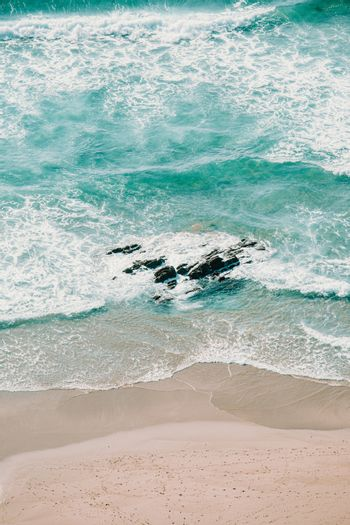Aerial view of the waves on the beach