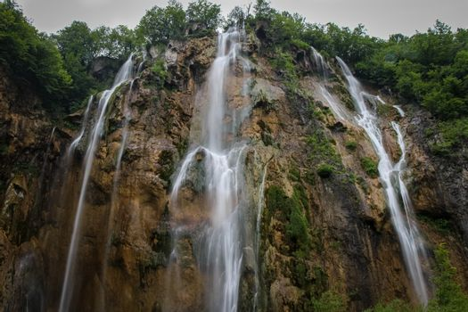 A long exposure of a large waterfall flowing at Plitvice Lakes, UNESCO World Heritage Site, Croatia
