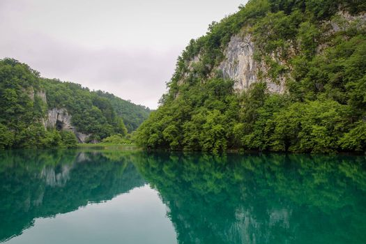 A reflection of a mountain valley on a lake at Plitvice Lakes, UNESCO World Heritage Site, Croatia
