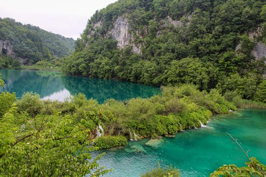 Water flowing over a waterfall between two lakes at Plitvice Lakes, UNESCO World Heritage Site, Croatia