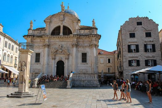 Dubrovnik, Croatia - July 15th 2018:The Church of Saint Blaise and Orlando's Column in Dubrovnik's old town, Croatia