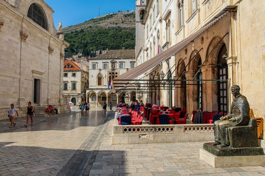 Dubrovnik, Croatia - July 15th 2018: A view along Ul. Pred Dvorom at the Rectors Palace, the UNESCO World Heritage Town of Dubrovnik, Croatia